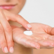Woman with Lotion on Hand