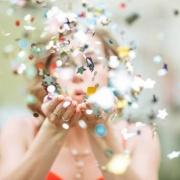Girl-Blowing-Confetti